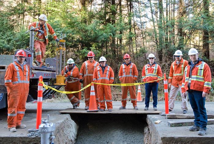 Crew of workers standing