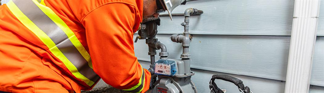 20-001.23.5 FortisBC customer service technician repairs a gas meter