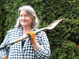The writer in her backyard with a shovel.