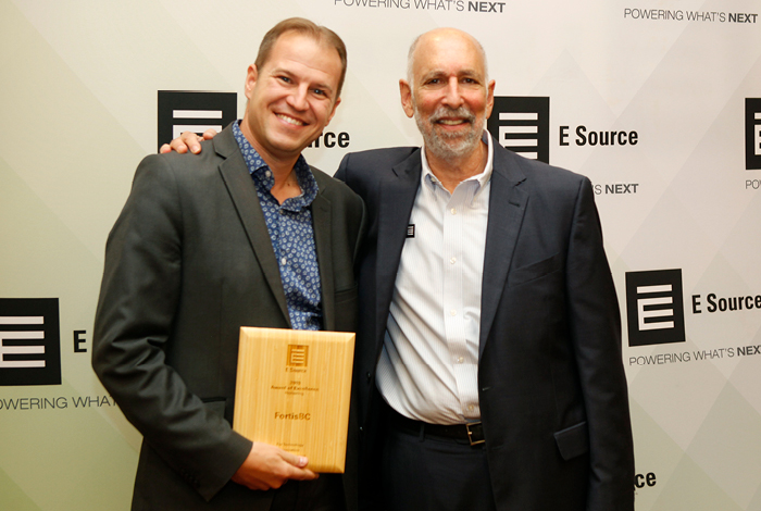 Jim Kobialko, Manager, Innovative Technologies, receiving the award from Wayne Greenburg, CEO of ESource.