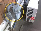 Appliances with compressors and motors, such as this air conditioning unit, should not be installed next to a gas meter.